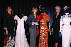 Karen Allen, Kate Capshaw, and Alison Doody posing with iconic outfits from their respective INDIANA JONES films in 2003