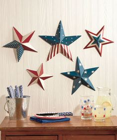 Decorate with the retro Americana of the Patriotic Wall Decor. Their eye-catching red, white and blue designs are a festive way to decorate for summer's patriotic holidays, or use them all year. The Set of 5 Painted Stars