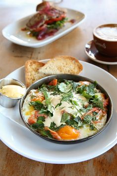 The better part of a whole smoked trout pokes up through a dish of baked eggs like brilliant pink icebergs in a breakfast sea. The Breakfast Club, Best Breakfast, Smoked Trout, Baked Eggs, Recipe Of The Day, Thai Red Curry, Restaurant, Sea, Dishes