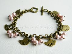 Pink Pearls and Birds Charm Bracelet by Bluebirdsanddaisies, £9.00