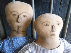 hand made dolls dressed in early fabric with hand stitched faces