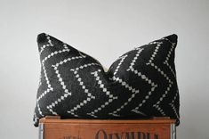 THE GRANADA AUTHENTIC AFRICAN MUD CLOTH SQUARE PILLOW COVER This pillow cover is made to order and may vary slightly from photo above.  FRONT: This pillow is handcrafted from authentic African mud cloth BACK: Natural denim, cream ZIPPER: Bottom close, brass zipper SIZE: 24x14  PLEASE