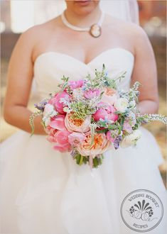 Wedding flowers Bridal bouquet bride RECIPE  5 stems of coral peonies  10 stems of Juliet Garden Roses  10 stems of white veronica  10 stems of white ranunculus  10 stems of lite pink ranunculus  7 stems of fresh lavender  7 stems of blue tweedia  5 stems of queens anne's lace  6 stems of dusty miller  the stems were wrapped in double face pink satin ribbon from midori