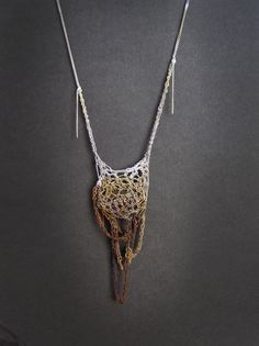 Necklace | Julia Berg. Crochet work with sterling silver chains, oxidized to different degrees of brown around a rutile clear quartz gemstone.