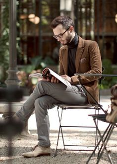 Shop this look for $344:  http://lookastic.com/men/looks/turtleneck-and-blazer-and-pocket-square-and-oxford-shoes-and-chinos/787  — Charcoal Turtleneck  — Tobacco Velvet Blazer  — Multi colored Silk Pocket Square  — Beige Leather Oxford Shoes  — Grey Chinos