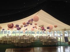 Stunning wedding marquee with starlight roof linings and pink pompoms!