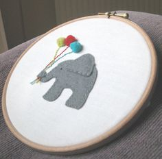 Embroidery Hoop Wall Art - New Baby - Appliqued elephant nursery wall hanging. $18.00, via Etsy.