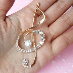 Kawaii bling bling music note metal cabochon with clear rhinestones. Great for cell phone deco, scrapbooking, jewelry making, etc.  Color: Gold