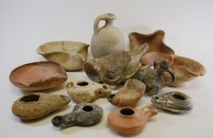 Middle Eastern Pottery Collection mostly oil lamps displayed here. Old Pottery, Greek Pottery, Ceramic Pottery, Pottery Art, Ceramic Art, Ceramic Lamps, Chandelier, Pottery Designs, Pottery Making