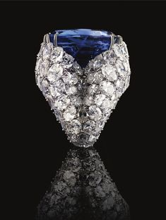 A MAGNIFICENT PLATINUM, SAPPHIRE AND DIAMOND RING, ALEXANDRE REZA The spectacular ring featuring an unheated oval-shaped Burmese sapphire weighing 52.31 carats, supported by a double bombé mounting set with 101 oval-shaped diamonds weighing 28.02 carats, 1975.
