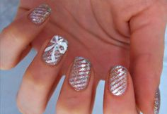 metallic stripes and a bow and I love the shape of the nail for short nails.