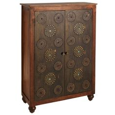 As you can see, this is one breathtaking cabinet. You may have gasped audibly upon seeing it—we thought we heard something. You may not know that it was lovingly hand-carved from solid mango hardwood by artisans. Or that inside, a fixed shelf and single drawer provide loads of storage. All you might see are those gleaming, copper-clad doors inlaid with sparkling glass beads. How do we know? It happened to us, too.