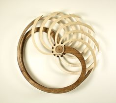Kinetic Sculpture by David C. Roy - Wood That Works | Kinetic Art - Nautilus - Spring driven kinetic sculpture