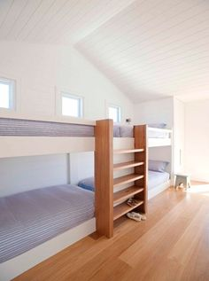 really clean bunk room idea for guests at a beach house, or for multiple children who need to share a living space