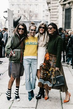 Street style. Fashion. Women's fashion. Fashion week. Style. Mini skirt. Style blogger. Fashion blogger. Midi skirt. Jeans. Tee. Hoodie. Purse. Clutch. Pattern mixing. Sunnies. Sunglasses. Sweaters. Fall fashion. Winter fashion. Maxi skirt.