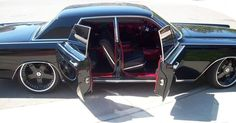 "1969 Lincoln Continental with rear ""suicide doors""."