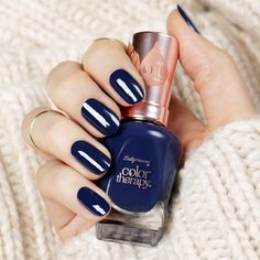 Get stronger nails while wearing gorgeous winter nail polish.  Sally Hansen new Color Therapy system moisturizes and nourishes nails. In 38 shades like Good as Blue, plus a strengthening Top Coat and Nail and Cuticle Oil, Color Therapy is enriched with Argan Oil so that you can achieve your most beautiful nails.