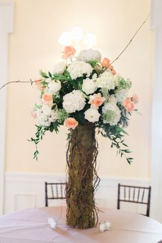 A very natural centerpiece: http://www.stylemepretty.com/florida-weddings/tampa/2015/05/15/rustic-chic-tampa-spring-wedding/ | Photography: Jacqui Cole - http://jacquicole.com/