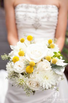 White roses and dahlias accented with yellow billy balls. Love this bouquet!
