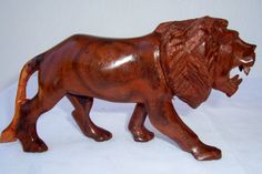 Rose Wood Animal Carvings Lion by Africanheritagegifts on Etsy