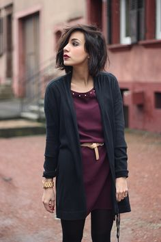 i like the: giant gold watch, soft-looking leather belt, color/length of the dress, the drapey cardigan over it. also her lipstick looks great and i would love to be able to pull that off.