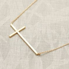 Tiny Sideways Cross Necklace in gold  ♥ the cross measures is approx. 19 x 10 mm - 0.7 x 0.4  ♥ Total length measures 16 ♥ Metal: gold Plated brass ♥ Color: Silver/Gold plated brass ♥ Comes in a Lovely gift box.  © Copyrights Flowerdays Photography 2013 Do Not Crop, Copy or Save