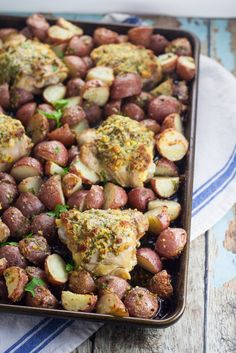 Easy, savory One Pan Garlic Roasted Chicken and Potatoes is a full meal, roasted in the oven all at once.