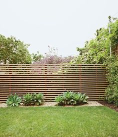 Image result for modern horizontal slatted fence with trees
