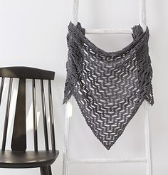 Unleash your inner mathlete and get stuck into this graphic shawl. This contemporary shawl is chic without being girly in any way. We're crazy for that geometric stitch pattern – it looks so impressive but isn't that difficult to create. Plus, the understated grey shade will go with most things in your wardrobe.