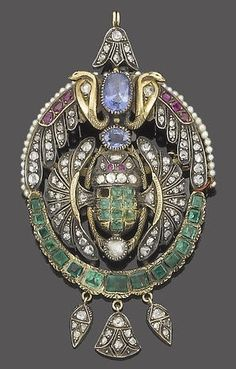 A gem-set and seed pearl brooch pendant, circa 1900. The elaborate openwork plaque decorated with variously cut diamonds, emeralds, rubies and seed pearls, centrally set with two oval mixed-cut sapphires between opposing cobras rising above a scarab with splayed wings set with square-cut emeralds, rose-cut diamonds and circular-cut ruby eyes, terminating in three articulated drops set with rose-cut diamonds, the reverse with engraved detail, mounted in silver and gold, later brooch fitting.