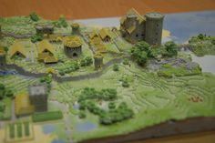 A 3D model of a minecraft-village, exported directly out of the game world using a modified minecraft.print() script, colored using CAD software, and printed on a Zprinter 650.