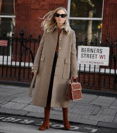 coat outfits: Jessie Bush wearing a checked coat with matching bag and boots