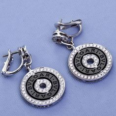 Bulgari Diamond Astrale Earrings | From a unique collection of vintage lever-back earrings at https://www.1stdibs.com/jewelry/earrings/lever-back-earrings/