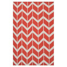 Handcrafted flatweave wool rug with a coral chevron motif.  Product: RugConstruction Material: 100% Wool
