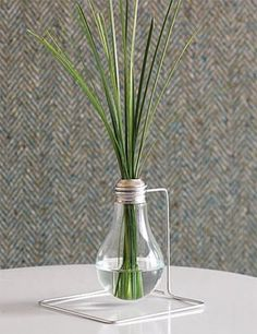 We always enjoy seeing ReadyMade's latest example of creative reuse, whether it's a plastic utensil centerpiece or a coffee can pendant lamp. This project, from their current issue, might be one of our favorites yet – a lightbulb bud vase!