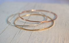 1 WAVE Bangle Bracelet- Gold Bracelet, 14K Rose Gold Filled, Yellow Gold Filled, or Sterling Silver, Hammered Bangle by GLAMROCKSdesigns on Etsy https://www.etsy.com/listing/150584632/1-wave-bangle-bracelet-gold-bracelet-14k