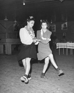 Young women dancing. Photograph by Peter Stackpole. Louisiana, USA, 1942.