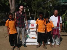 Jeremy and the boys at New Migrant School in MaeSot Thailand, along the Thai-Burma border. Jeremy is delivering rice and curry to the orphaned children.