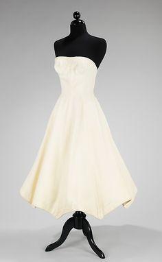 "Carolyn Schnurer (American, 1908–1998). ""Parasol Sun Dress,"" 1952. Textile by Fuller Fabrics. American. The Metropolitan Museum of Art, New York. Brooklyn Museum Costume Collection at The Metropolitan Museum of Art, Gift of the Brooklyn Museum, 2009; Gift of Carolyn Schnurer, 1952 (2009.300.3142)"
