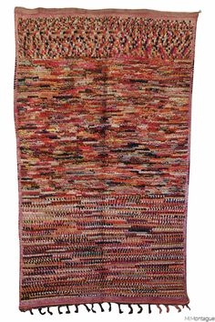 This vintage Moroccan Boujad carpet is like a modern work of art.  All hand knotted. All wool. This one is particularly cozy underfoot.  Whenever I get these carpets they sell out very quickly and so grab yours.  They look great in clusters. Available at Maryam Montague's online Souk!