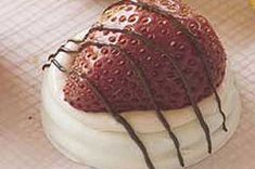 1/4cup  PHILADELPHIA Whipped Cream Cheese Spread12 OREO White Fudge Covered Cookies6 fresh strawberries, halved1square  BAKER'S Semi-Sweet Chocolate, melted