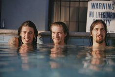 "Nirvana in the pool during the ""Nevermind"" photoshoot, 1991. Photograph by Kirk Weddle."