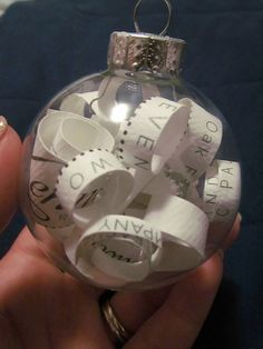 Wedding Gift..The invitation from the wedding is cut up and placed in ornament!