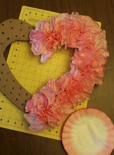 Heart Shaped Coffee Filter Valentine's Wreath  a good tip to do a special decoration to your living room ore just on the wall in your room<3<3<3<3 good luck!