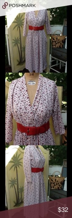 VTG BOHO FESTIVAL HIPPIE WRAP DRESS Fabulous Vtg hippie boho wrap dress,it's in a white with a burgundy tiny floral pattern,this is so cute,love it with the wide red belt(not included) features 3/4 sleeves and 1 front patch pocket....just throw on a pair of tall boots a wide belt and chunky necklace and you are TRES CHIC!!!! Will post measurements a bit later Vintage Dresses Maxi