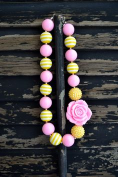 Girly girl glam Pink and Yellow gumball chunky bead necklace. $12.00, via Etsy.