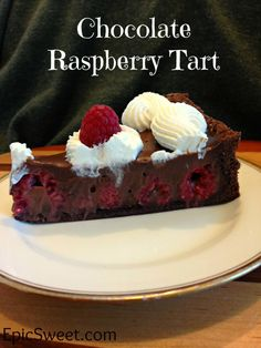 Chocolate Raspberry Tart: this simple tart is made with a chocolate cookie crust then filled with fresh raspberries and chocolate ganache! It's easier to make then it looks and it is so delicious!!