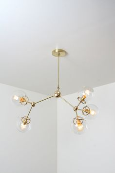 Unique handmade brass light fixture with glass shades - 'element Y'