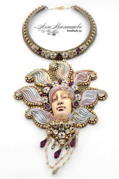 Lotos necklace with Swarovski crystals ceramic face by beadladyru Ribbon Jewelry, Bead Embroidery Jewelry, Beaded Embroidery, Wire Jewelry, Jewelry Art, Beaded Jewelry, Handmade Jewelry, Beaded Necklace, Jewelry Design