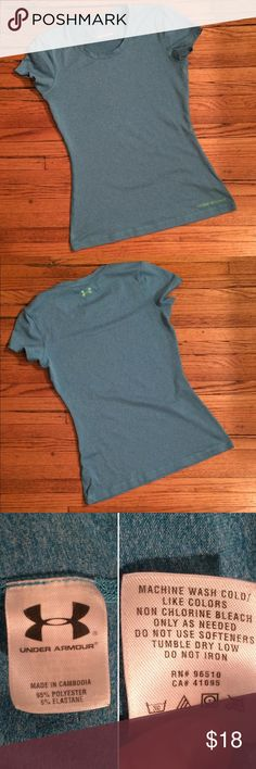 Under Armour Heat Gear Tee In excellent used condition. This marine blue Heat Gear tee has the Under Armour logo on the back between the shoulder blades, and the band on the front hem in green (see last picture). Great basic piece. Make me an offer. 25% discount on bundles. Under Armour Tops Tees - Short Sleeve